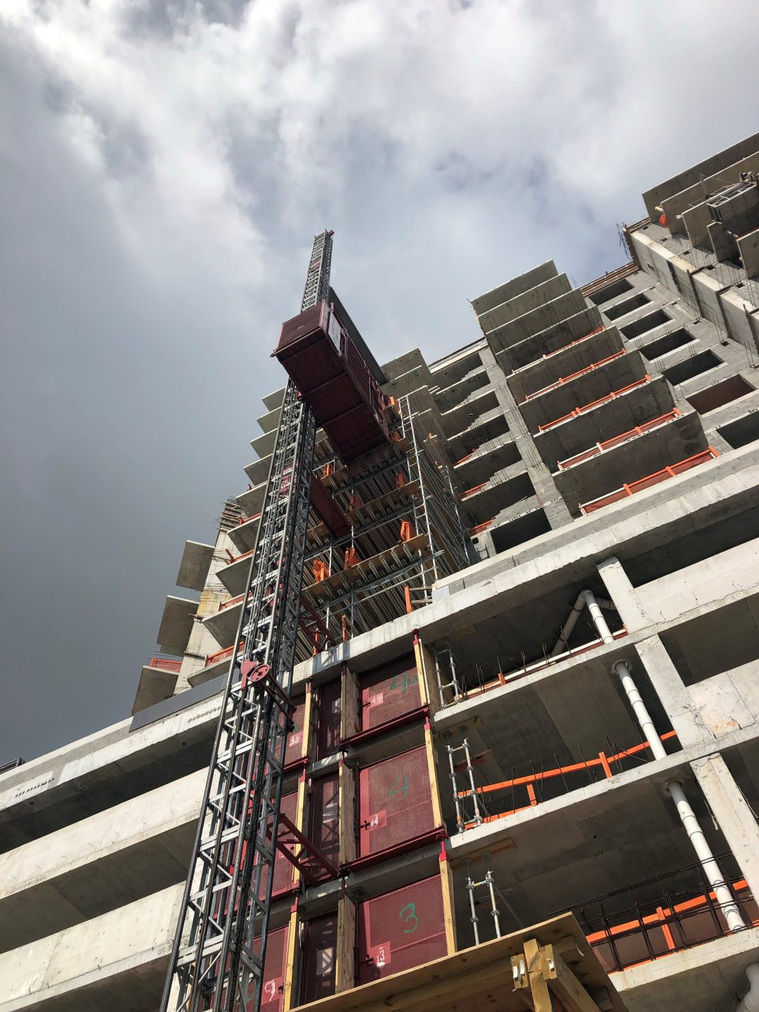 Hoisting solutions and equipment for commercial building project