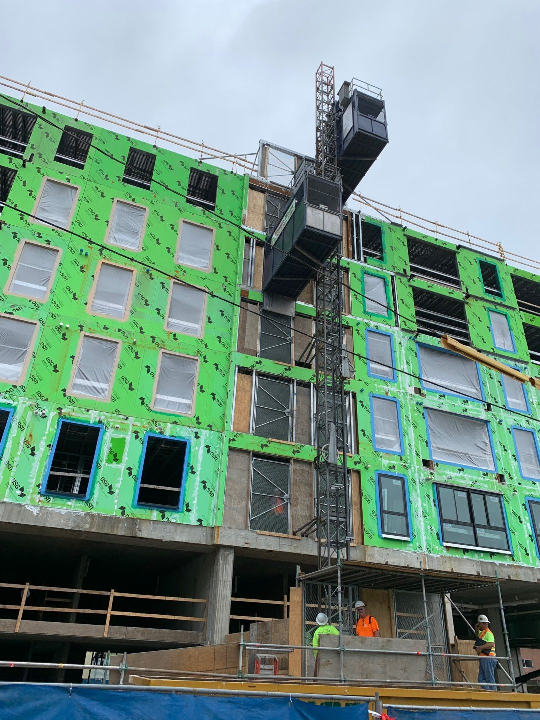Multi-family condos typical installation with buck hoist