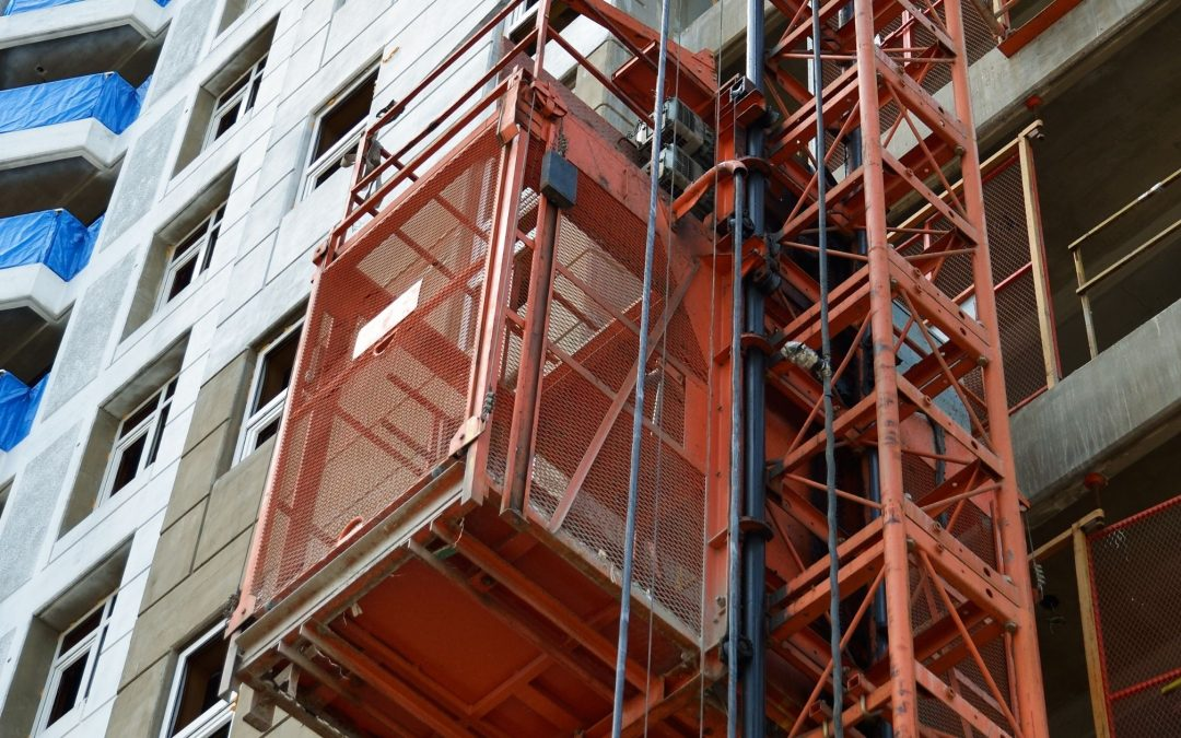 What is the difference between a hoist and a lift in construction?