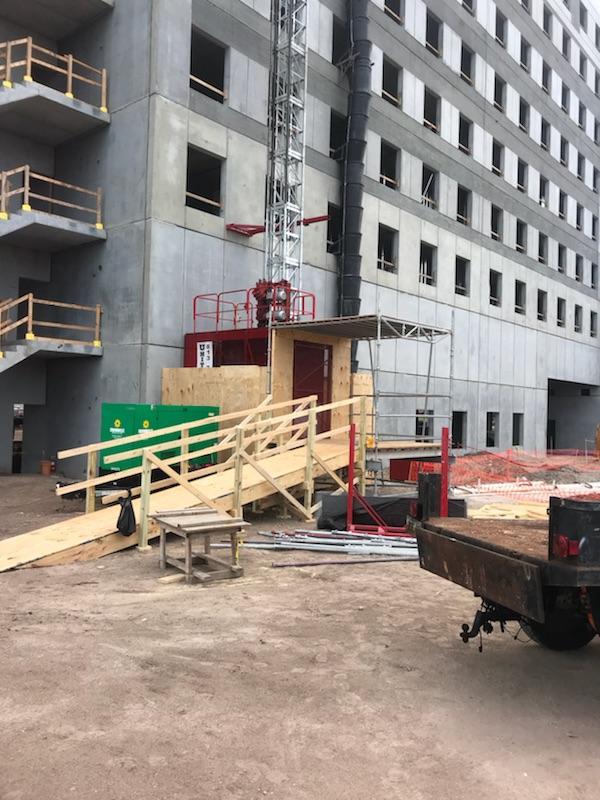 Construction hoist chute setup