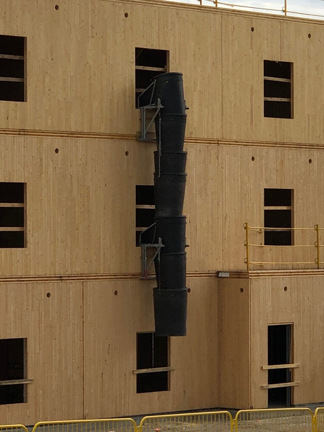 Poly Chute installation on wooden building