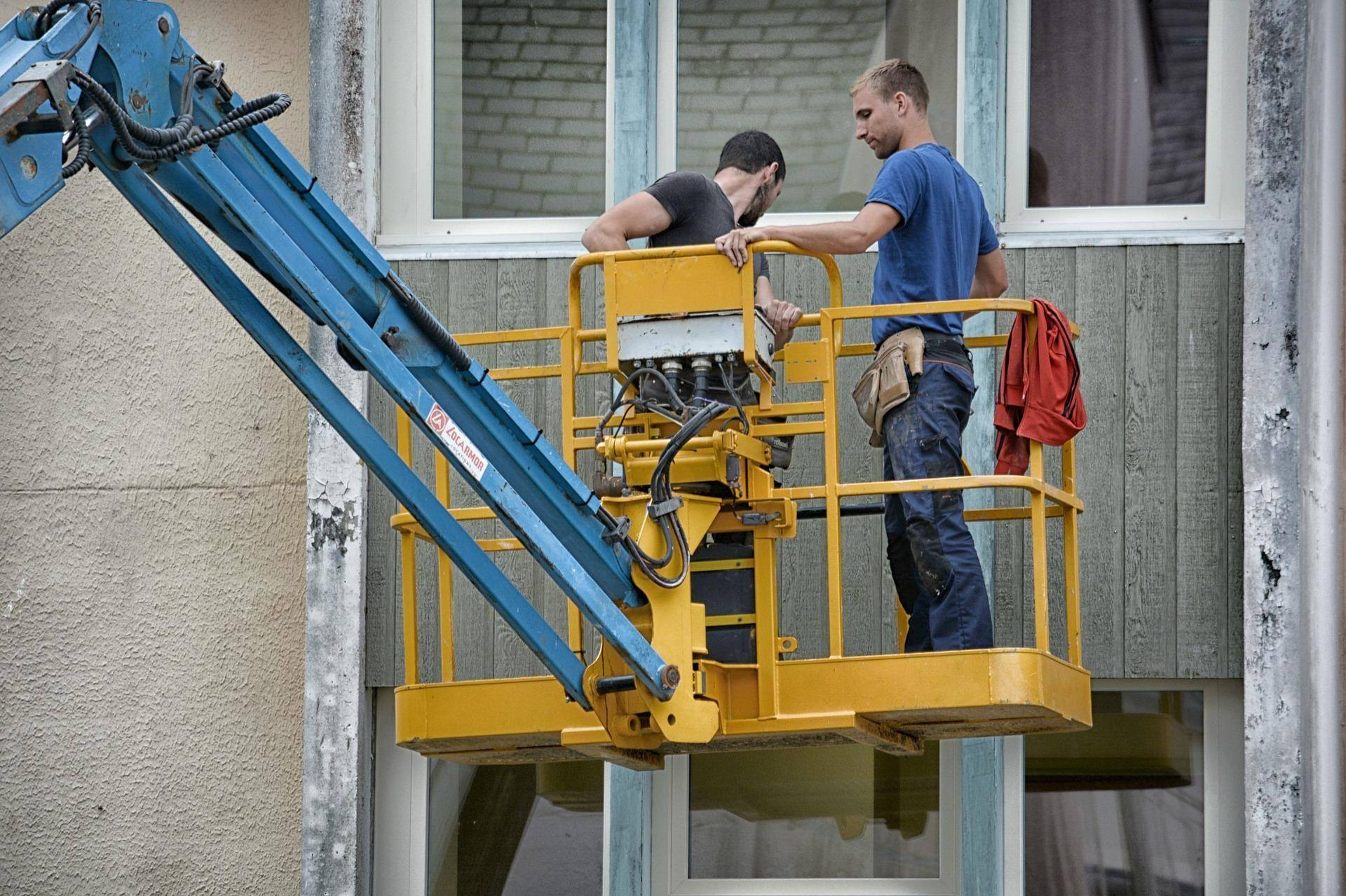 construction workers in a hoist
